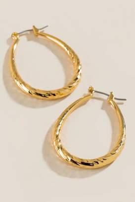 francesca's Maevyn Diamond Cut Oval Hoops Earrings - Gold