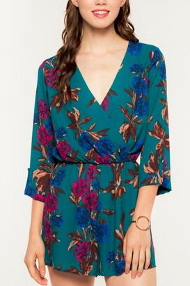 Everly Long Sleeve Floral Romper $58 thestylecure.com