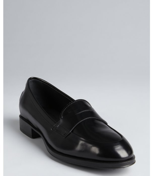 Tod's black shined leather penny loafers