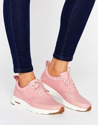 Nike Thea Basket Weave Trainers In Pink