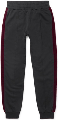 Alexander McQueen Tapered Velvet-Trimmed Cotton-Jersey Sweatpants $845 thestylecure.com