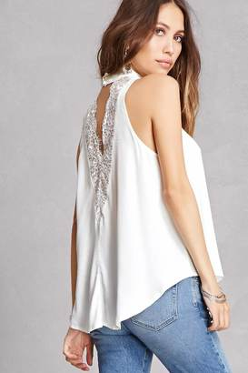 FOREVER 21+ Lace-Back Swing Top $35 thestylecure.com