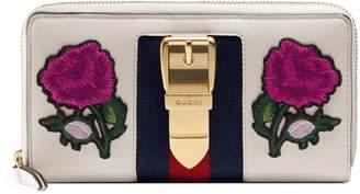 Gucci Sylvie embroidered leather zip around wallet