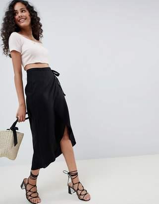 Asos Design DESIGN wrap midi skirt with tie