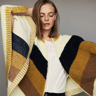Maje Poncho with sheepskin
