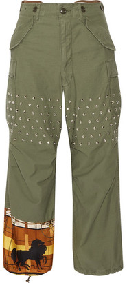 Junya Watanabe - Printed Satin-paneled Studded Cotton-blend Wide-leg Pants - Army green $1,090 thestylecure.com