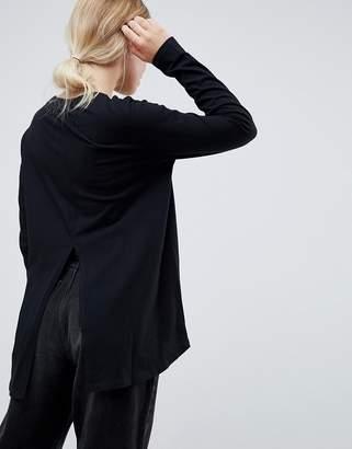Asos Design DESIGN long sleeve t-shirt with dip hem and split back in black
