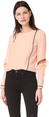 3.1 Phillip Lim Top with Ruffle & Zip Sleeves $495 thestylecure.com