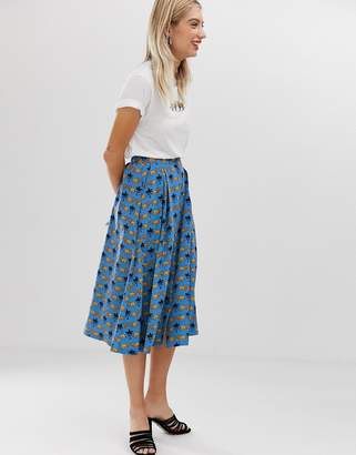 5f398fe930 Monki lion print buttoned midi skirt in blue