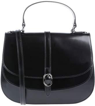 At Yoox Innue Handbags