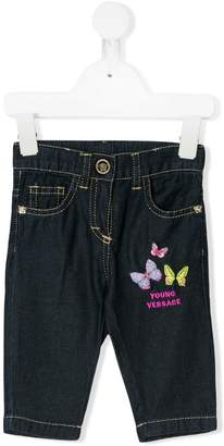 Versace butterfly embroidered jeans