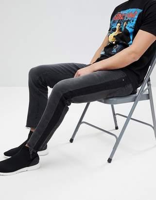 Asos DESIGN slim jeans in washed black with side stripe