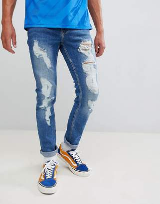 Co Brooklyn Supply Brooklyn Supply skinny jeans in stonewash blue with rips