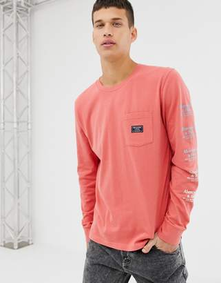 Abercrombie & Fitch pocket logo sleeve print long sleeve top in coral