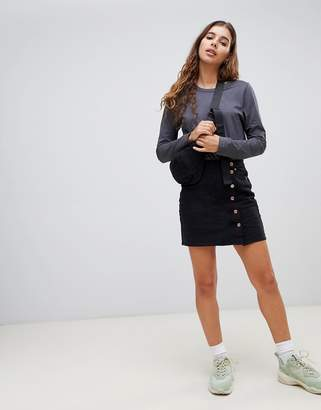Weekday side button mini skirt in black