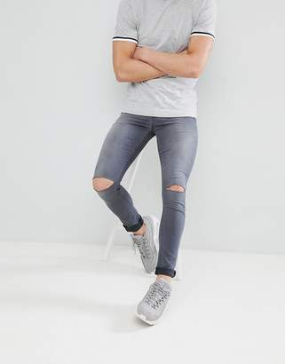 Asos DESIGN super spray on jeans in washed gray with knee rips