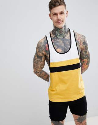 Asos DESIGN extreme racer back tank with color block in yellow