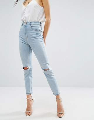 ASOS FARLEIGH High Waist Slim Mom Jeans In Beech Light Stonewash with Busted Knees and Chewed Hems $53 thestylecure.com