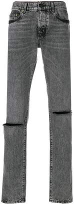 Saint Laurent low rise busted knee jeans