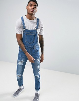 Heros Heroine Overalls In Blue With Rips $110 thestylecure.com