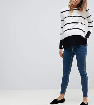 a7feab96a86 at ASOS · Asos DESIGN Maternity Ridley high waist skinny jeans in mid blue  wash with under the bump