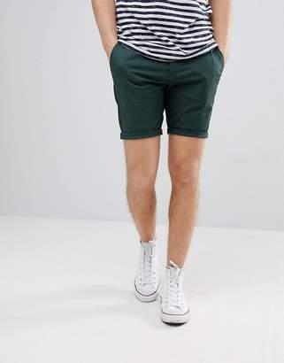 Asos DESIGN Skinny Chino Shorts In Bottle Green
