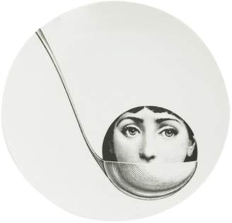 Fornasetti face in ladle printed plate