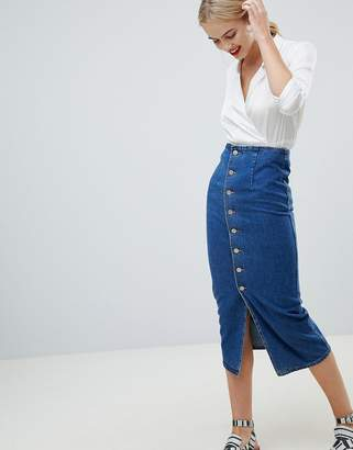 Asos DESIGN denim midi skirt with buttons in midwash blue