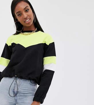 Asos Tall DESIGN Tall sweatshirt in neon color block with drawstring hem