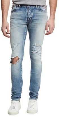 Saint Laurent Dirty Distressed Skinny Jeans with Blowout Knee, Blue $850 thestylecure.com