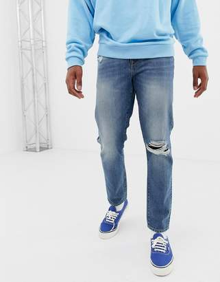 Asos DESIGN 12.5oz slim jeans in vintage mid wash with knee rips