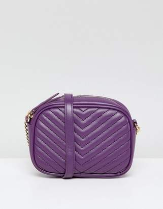 New Look quilted cross body bag in purple