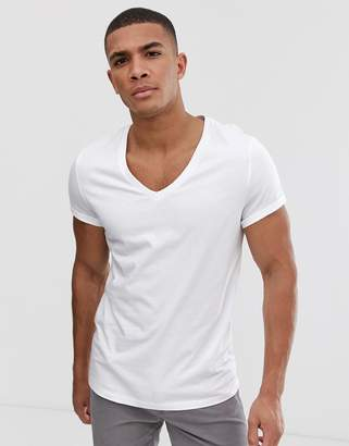 e56938ddd24d Asos Design DESIGN t-shirt with deep v neck and roll sleeve in white
