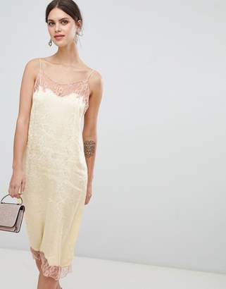 Asos DESIGN soft jacquard slip dress with delicate lace inserts