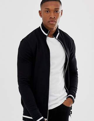 Asos DESIGN muscle jersey track jacket in black with contrast tipping