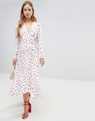 Asos Design DESIGN wrap front jacquard midi dress with long sleeves in red polka dot