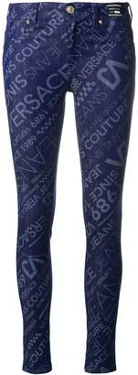 Versace all over logo skinny jeans