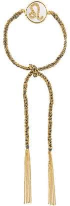 Carolina Bucci tassel bracelet with zodiac charm