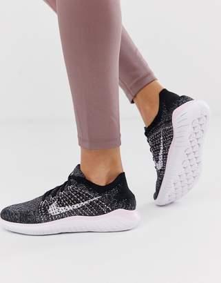 ff56122334d5 Nike Running Free Run Flyknit Sneakers In Black