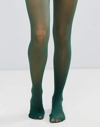 Asos DESIGN recycled 40 denier tights in forest green