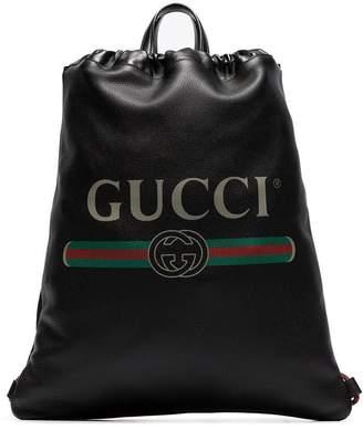 Gucci black logo print leather drawstring backpack