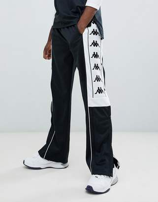 Kappa joggers with popper hem and large logo taping in black