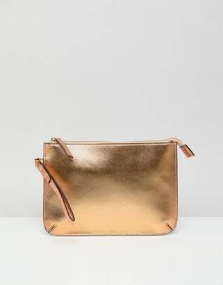 Asos Design DESIGN zip top wristlet clutch bag in metallic