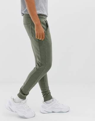 Asos DESIGN skinny joggers with ribbed side stripe and acid wash