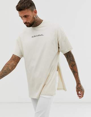 Asos Design DESIGN oversized longline t-shirt with subliminal chest print and side split