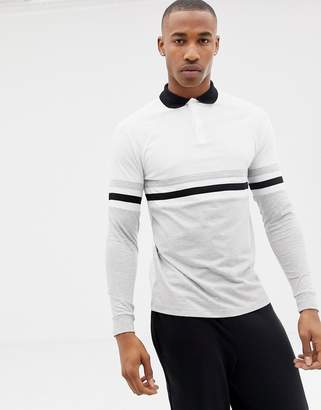 Asos DESIGN long sleeve polo shirt with contrast body and sleeve panels in white