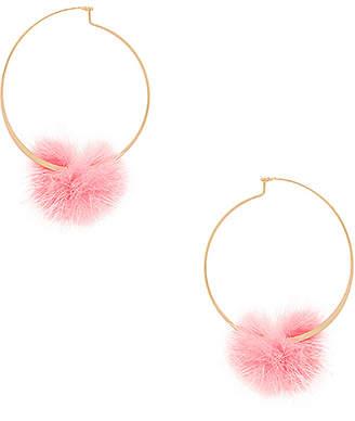 Ettika Fuzzy Pom Pom Hoops in Metallic Gold. $31 thestylecure.com