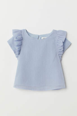H&M Glittery blouse