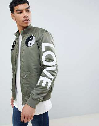 Love Moschino bomber with peace logo