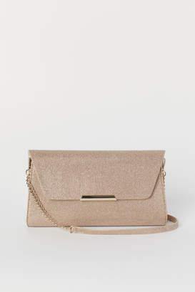 H&M Glittery clutch bag